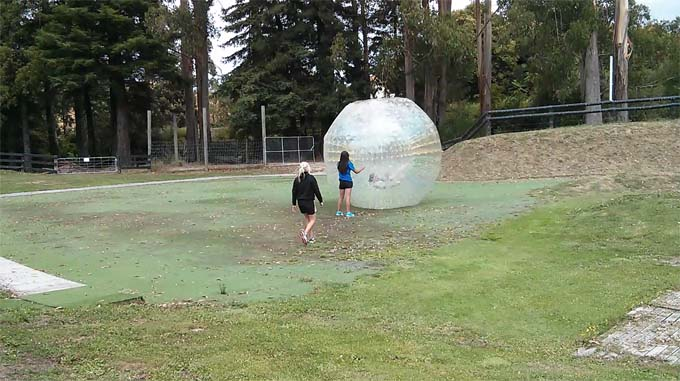 Jill has been stopped by the staff and they are preparing to help her out of the orb.