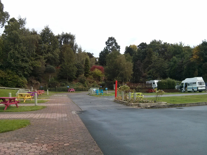 The Dunedin Holiday Park campsite, we stayed in the tenting area beyond the trees