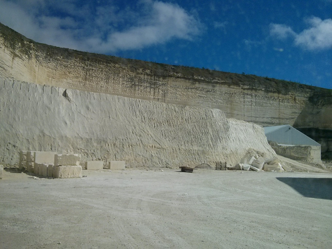 The quarry pit looking upward. A good example of how deep they have cut into the earth for this natural product.