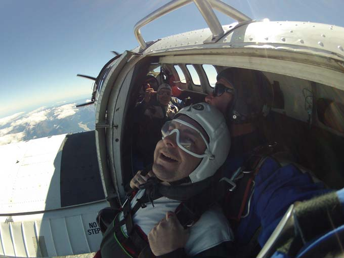 You're just hanging out of the plane at 15,000 feet until the instructor decides to fall out completely!