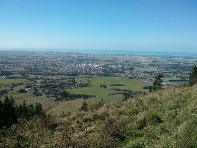 The Waimate township view from top of the surrounding hills. You can see the Pacific Ocean as the top blue sliver.