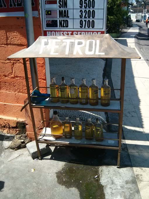 Petrol refills on the street in old Absolut Vodka glass bottles.