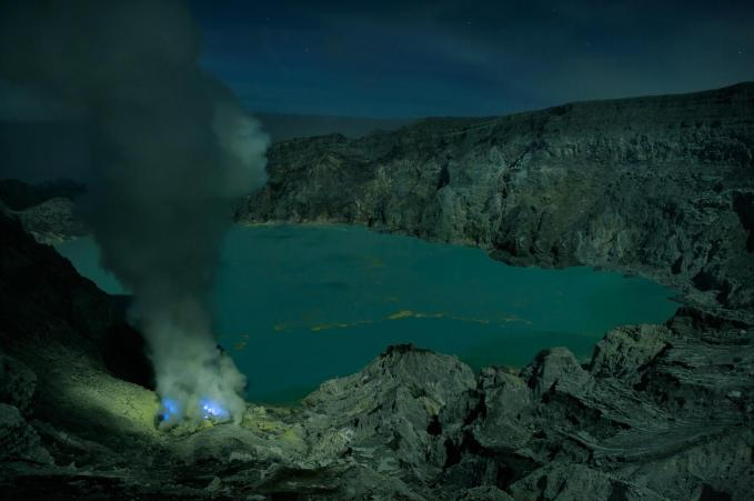 Photo by Oliver Grunewald. A clear night and you can see the crater with the blue flames clearly.